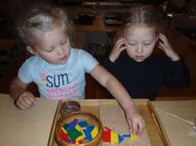 Reya and Avalon work together using mosaic shapes and very tiny nails.